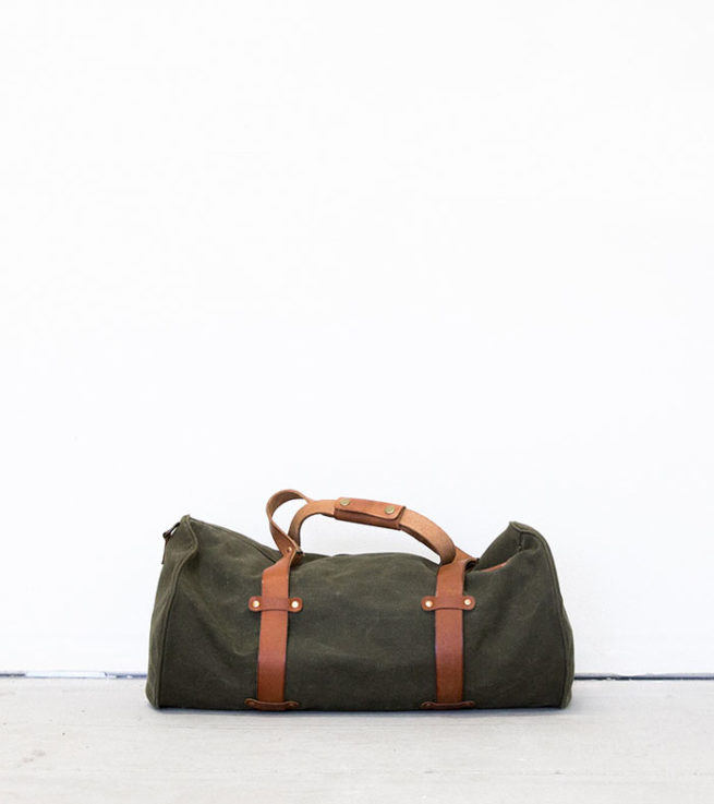 green and brown duffel bag on white surface